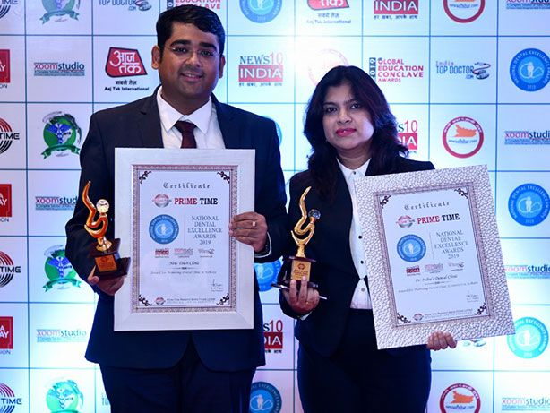 Dr. Shubhasatta Indra and Dr. Romila Paul with awards